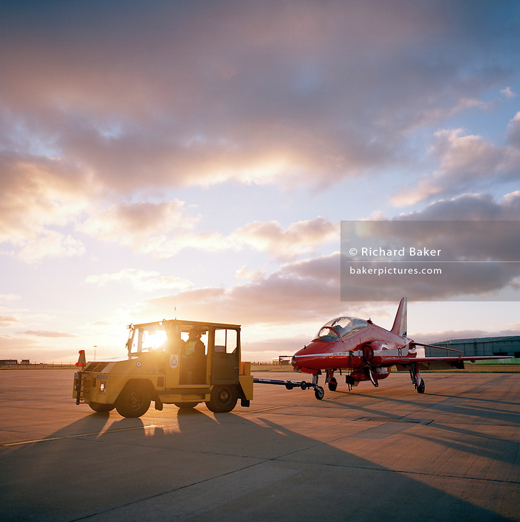 Towing a BAE Systems Hawk jet of the 'Red Arrows', Britain's Royal Air Force aerobatic team after day's winter training.