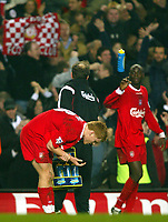 Photograph: Scott Heavey.<br /> Chelsea v Liverpool. FA Barclaycard Premiership.  07/01/2004.<br /> John Arne Riise holds his wrist after the final whistle