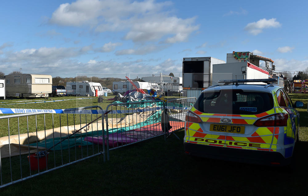"""© Licensed to London News Pictures. 27/03/2016. London, UK. A general view of a police cordon in Harlow Town park where a girl died when a bouncy castle she was playing in """"blew away by some distance"""". Two people are being held on suspicion of manslaughter by gross negligence following the incident which took place in Harlow Town Park in Essex Photo credit : Hannah McKay/LNP"""