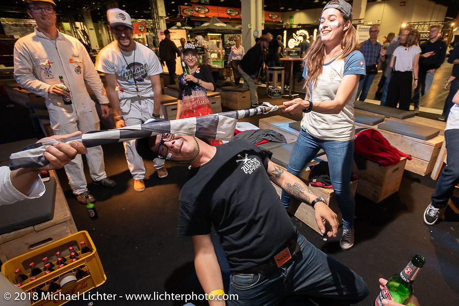 Seb does Limbo at the Sultans of Sprint party during the Intermot International Motorcycle Fair. Cologne, Germany. Saturday October 6, 2018. Photography ©2018 Michael Lichter.