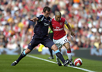 Photo: Olly Greenwood.<br />Arsenal v West Ham United. The Barclays Premiership. 07/04/2007. West Ham's Lucas Neil and Arsenal's Gael Clichy