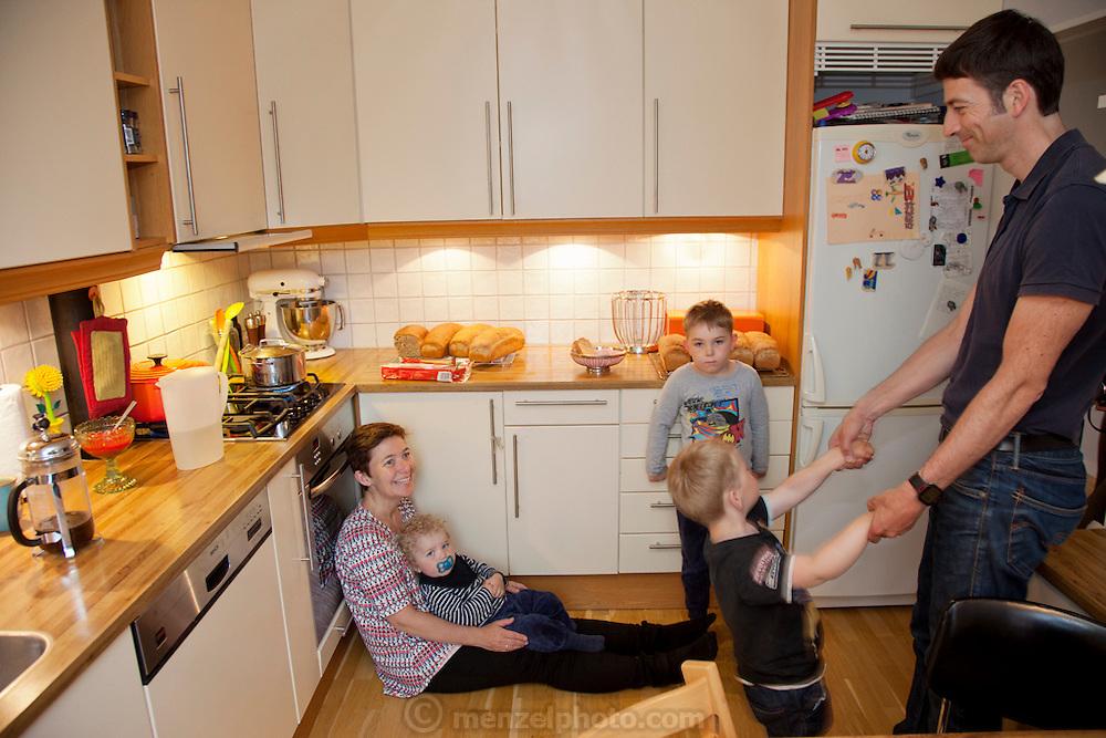 Ottersland Dahl Family. Gunhild Valle Ottersland, 45, her husband Tor Erik Dahn, 39, and their three children, Olav, 6 Hakon, 3, and Sverre, 1.5 of Gjettum, Norway, with their typical week's worth of food in June. Food expenditure for one week: 2211.97 Norwegian Kroner; $379.41 USD. Model-Released.