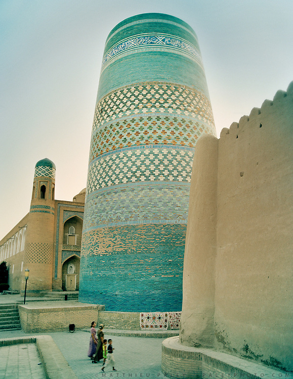The famed Kalta Minor minaret, at the entrance of the ancient preserved city of Khiva, redondent of slave caravans barbaric cruelty and terrible journyes across deserts, on the ancient Silk Road. Uzbekistan.