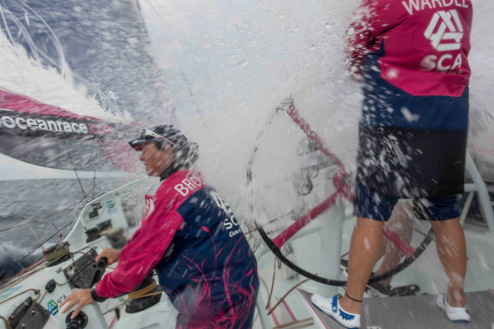April 29, 2015. Leg 6 to Newport onboard Team SCA. Day 10. Carolijn Brouwer and Liz Wardley get hammered by a wave.