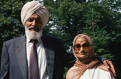 Portrait of elderly couple standing outside,