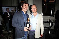 OLI BARKER and ED WILSON at the Tatler Restaurant Awards 2011 held at the Langham Hotel, Portland Place, London on 9th May 2011.