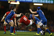 Taulupe Faletau of Wales (8) is stopped by a hard tackle from Mathieu Bastareaud of France. Wales v France, NatWest 6 nations 2018 championship match at the Principality Stadium in Cardiff , South Wales on Saturday 17th March 2018.<br /> pic by Andrew Orchard, Andrew Orchard sports photography