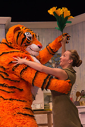 "© Licensed to London News Pictures. 03/07/2014. London, England. Matthew Dudley as The Tiger with Jenanne Redman as Mummy. The musical play ""The Tiger Who Came to Tea"" returns to London's West End. With Abbey Norman as Sophie, Jenanne Redman as Mummy and Matthew Dudley as the Tiger. The stage adaptation of Judith Kerr's tale is directed by David Wood. The show opens on 2 July and runs until 7 September 2014 at the Lyric Theatre in London. Photo credit: Bettina Strenske/LNP"