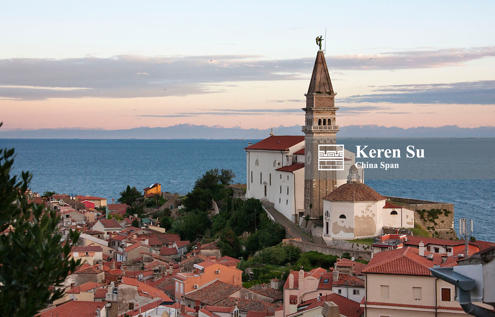 Punta Lighthouse and red roofed houses along Adriatic coast, Piran, Slovenia