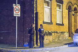 © Licensed to London News Pictures . 08/09/2016 . Rochdale , UK . Two PCSOs stand outside a house at the junction of Rooley Moor Road and Preston Street in Spotland as a 25 year old man has been arrested for murder following the death of an 8 month old baby boy on Tuesday 6th September 2016 . A 24 year old woman is also in custody . Photo credit: Joel Goodman/LNP