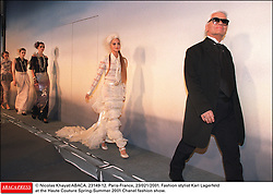 © Nicolas Khayat/ABACA. 23149-12. Paris-France, 23/021/2001. Fashion stylist Karl Lagerfeld at the Haute Couture Spring-Summer 2001 Chanel fashion show.