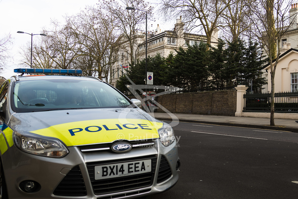 A police car is parked outside the Russian embassy in Kensington following British Prime Minister Theresa May's decision to expel 23 diplomatic officials in the wake of the Salisbury poisoning incident which has former double agent Sergei Skripal and his daughter along with a police officer who tried to assist.. London, March 14 2018.