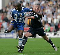 Photo: Dave Howarth.<br />Wigan Athletic v Bolton Wanderers. The Barclays Premiership. 02/10/2005. Wigans Damien Frances gets a shove from Kevin Nolan