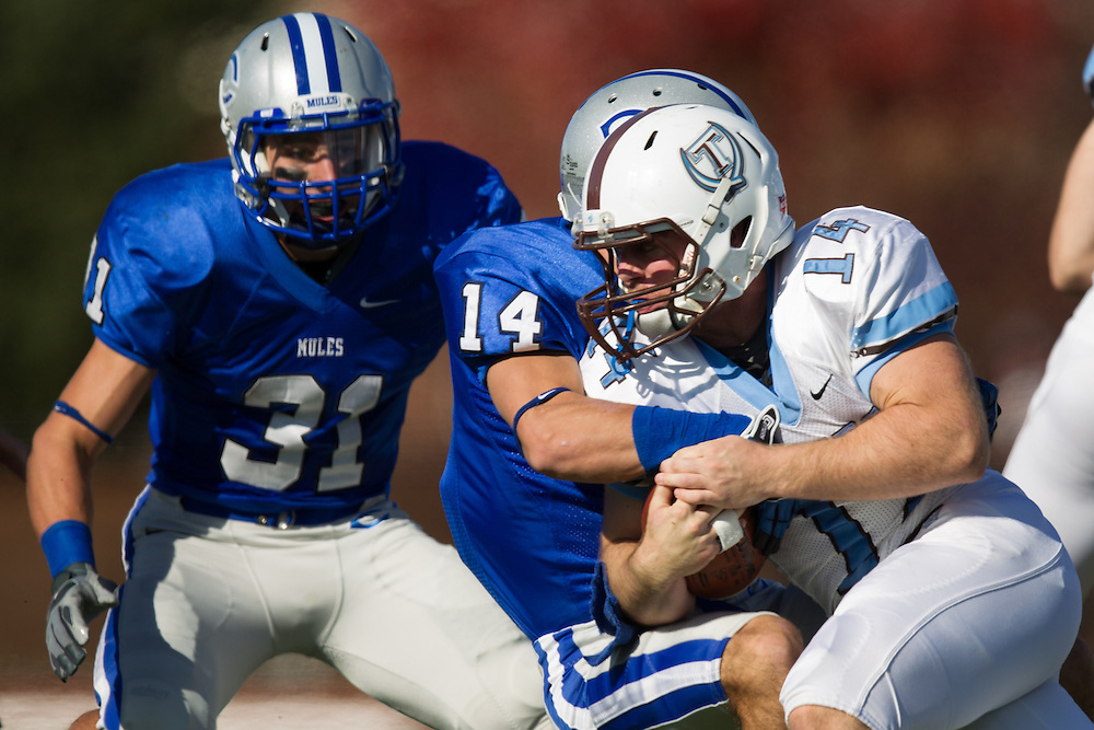 Jason Buco, of Colby College, makes a tackle during a NCAA Division III football game on November 2, 2013 in Waterville, ME. (Dustin Satloff/Colby College Athletics)