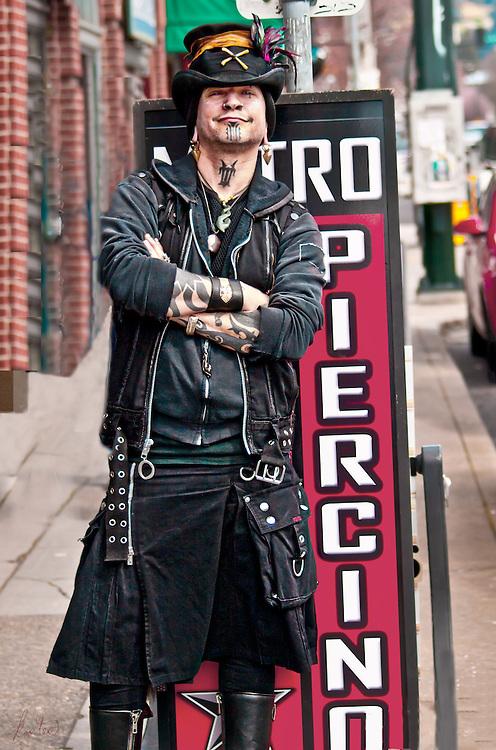 Portrait of a man who runs a tattoo parlor.