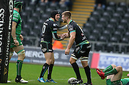 Olly Cracknell of the Ospreys ® celebrates with his teammate Sam Davies after he scores his teams 2nd try.  Guinness Pro12 rugby match, Ospreys v Connacht rugby at the Liberty Stadium in Swansea, South Wales on Saturday 7th January 2017.<br /> pic by Andrew Orchard, Andrew Orchard sports photography.