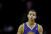 Nov 24, 2010; Houston, TX, USA; Golden State Warriors point guard Stephen Curry (30) chews on his mouthguard during the fourth quarter  against the Houston Rockets at the Toyota Center. The Rockets won 111-101. Mandatory Credit: Thomas Campbell-US PRESSWIRE