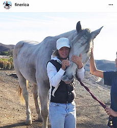 """Kirstie Alley releases a photo on Twitter with the following caption: """"""""Horse owner and horse reunited it's a miracle! #JustBElieve"""""""". Photo Credit: Twitter *** No USA Distribution *** For Editorial Use Only *** Not to be Published in Books or Photo Books ***  Please note: Fees charged by the agency are for the agency's services only, and do not, nor are they intended to, convey to the user any ownership of Copyright or License in the material. The agency does not claim any ownership including but not limited to Copyright or License in the attached material. By publishing this material you expressly agree to indemnify and to hold the agency and its directors, shareholders and employees harmless from any loss, claims, damages, demands, expenses (including legal fees), or any causes of action or allegation against the agency arising out of or connected in any way with publication of the material."""
