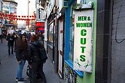 Hairdressers and barbers in Soho offering cuts for men and women in Chinatown, London, England, United Kingdom.
