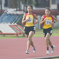 HCI's Arissa Rashid (#241) pulling away from the pack with teammate Vera Wah (#270) in the National A Division Girls 1500m race with a time of 05:13.12. (Photo © Stefanus Ian)