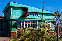 Russia, Sakhalin. Okhotskoye is a small village at the south east coast of Sakhalin, not far from Yuzhno-Sakhalinsk. Residential buildings are mostly made of wood.