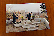 A photo of Harry Hogan (back left) and his mother Valerie ??? (front third from left) visiting the grave of Rita and Masataka Taketsuru in Japan in 1998. Rita and Masataka's adopted son, Takeshi, is second from right. East Kilbride, Glasgow, UK, June 24, 2014. Rita Taketsuru was the Scottish wife of the founder of Nikka Whisky, Masataka Taketsuru. She was born in Kirkintilloch, near Glasgow, Scotland.