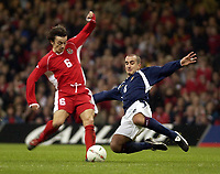 Picture: Henry Browne.<br /> Date: 18/02/2004.<br /> Wales v Scotland Friendly International.<br /> <br /> Scotland's Paul Ritchie flies in on Simon Davies who has to go off injured.
