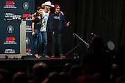 """DALLAS, TX - MARCH 13:  Megan Olivi and Donald """"Cowboy"""" Cerrone pose for a photo with a fan before the UFC 185 weigh-ins at the Kay Bailey Hutchison Convention Center on March 13, 2015 in Dallas, Texas. (Photo by Cooper Neill/Zuffa LLC/Zuffa LLC via Getty Images) *** Local Caption *** Megan Olivi; Donald Cerrone"""