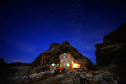 Rifugio T. Pedrotti alla Tosa in the Dolomites. A night, long exposure photograph under the stars.