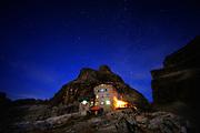 Rifugio T. Pedrotti alla Tosa in the Dolomites. A night, long exposure photograph under the stars.
