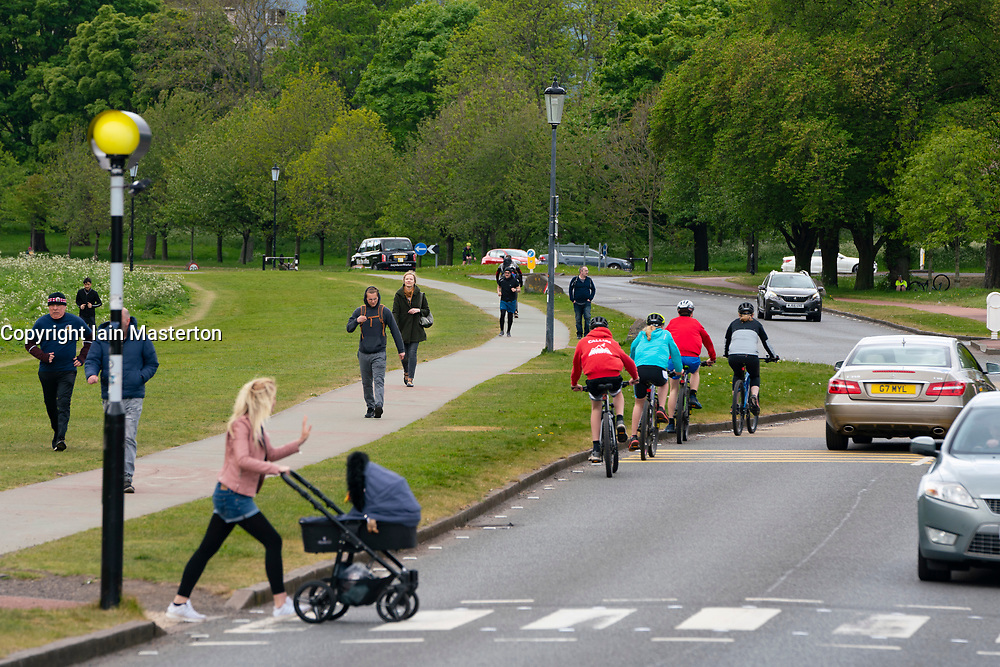 Edinburgh, Scotland, UK. Police patrolling Holyrood Park in Edinburgh. Police presence was high because of a rumoured anti-lockdown protest in the park that was promoted on Facebook. The park was busy with members of the public exercising and doing sports. Iain Masterton/Alamy Live News