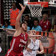 Germany's Robin Benzing and Turkey's Semih Erden (L) during their Adidas Istanbul Cup 2012 basketball final match Germany between Turkey at the Abdi ipekci Arena in Istanbul Turkey on Friday 03 August 2012. Photo by TURKPIX