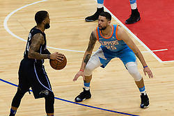 March 10, 2018 - Los Angeles, CA, U.S. - LOS ANGELES, CA - MARCH 10: LA Clippers guard Austin Rivers (25) defends Orlando Magic guard D.J. Augustin (14) during the game between the Orlando Magic and the LA Clippers on March 10, 2018, at STAPLES Center in Los Angeles, CA. (Photo by David Dennis/Icon Sportswire) (Credit Image: © David Dennis/Icon SMI via ZUMA Press)
