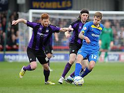 Bristol Rovers' Matt Harrold chases AFC Wimbledon's Harry Pell - Photo mandatory by-line: Dougie Allward/JMP - Mobile: 07966 386802 05/04/2014 - SPORT - FOOTBALL - Kingston upon Thames - Kingsmeadow - AFC Wimbledon v Bristol Rovers - Sky Bet League Two