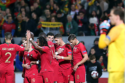 LISBON, Nov. 21, 2018  Portugal's players celebrate after scoring during the UEFA Nations League soccer match League A Group 3 between Portugal and Poland in Guimaraes, Portugal on Nov. 20, 2018. The match ended with a 1-1 tie. (Credit Image: © Catarina Morais/Xinhua via ZUMA Wire)