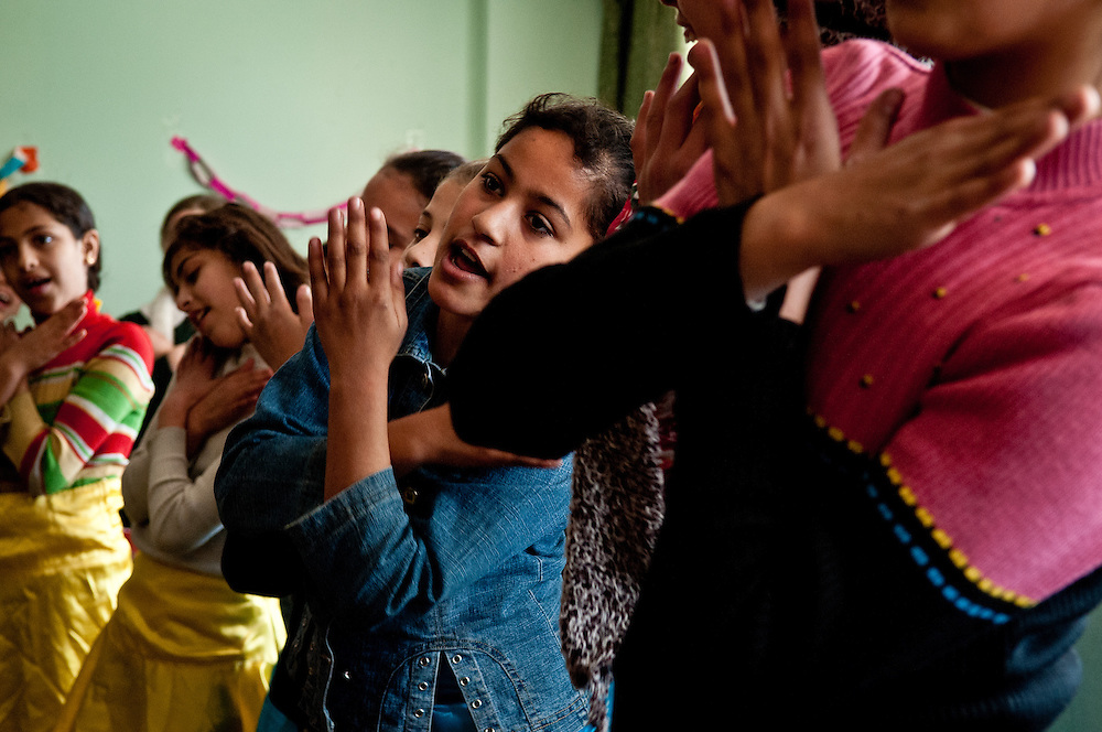 Girls do a dance for peace at the Amar Ibn Yasser Youth Center in Gaza City.