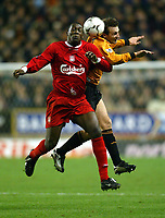 Photo: Scott Heavey.<br /> Wolverhampton Wanderers v Liverpool. FA Barclaycard Premiership. 21/01/2004.<br /> Emile Heskey beats Lee Naylor to the ball