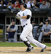 CHICAGO - JUNE 06:  Paul Konerko #14 of the Chicago White Sox hits a home run against the Seattle Mariners in the fourth inning on June 6, 2011 at U.S. Cellular Field in Chicago, Illinois.  The White Sox defeated the Mariners 3-1.  (Photo by Ron Vesely)  Subject:  Paul Konerko