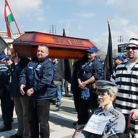 Protesters attend an anti-government rally in Budapest, Hungary on April 16, 2011..Thousands of Hungarians, including policemen and firefighters, on Saturday protested against the government's austerity measures. The government has launched a package of fiscal reforms to cut the budget deficit, including scrapping early retirement, which mostly affects law enforcement personnel.