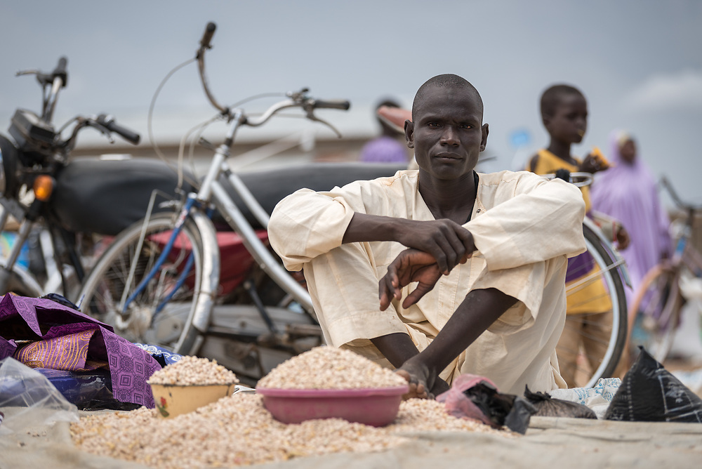 30 May 2019, Mokolo, Cameroon: A man sells his produce in the marketplace of the Minawao camp for Nigerian refugees.  The Minawao camp for Nigerian refugees, located in the Far North region of Cameroon, hosts some 58,000 refugees from North East Nigeria. The refugees are supported by the Lutheran World Federation, together with a range of partners.