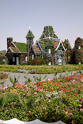 House covered in flowers at Miracle Garden Dubai United Arab Emirates