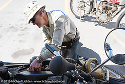 Hans Coertse of South Africa works on his 976c twin cylinder 1913 Matchless Model 5B Motorcycle at a stop on the eastern plains of Colorado during the Motorcycle Cannonball Race of the Century. Stage-9 Dodge City, KS to Pueblo, CO. USA. Monday September 19, 2016. Photography ©2016 Michael Lichter
