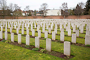 Rows and rows of headstone of fallen soldiers. Faubourg DAmiens cemetery is the burial site of 2678 identified casualties and a memorial to thousands more from the First and Second World War.  It is looked after and managed by the Commonwealth War Graves Commission in the town of Arras, France.
