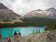 Taking in the view over beautiful, remote Lake O'Hara in Yoho National Park, near Field, British Columbia, Canada; MRs available