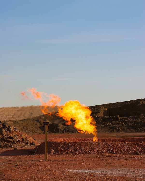 Ground level natural gas flare at an oil drilling site, Oil development, drilling and exploration in the Baaken region of North Dakota