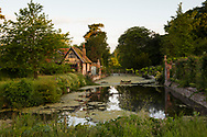 A bridge spanning the 12 century moat surrounding the garden and Tudor manor house at Hindringham Hall, Hindringham, Norfolk