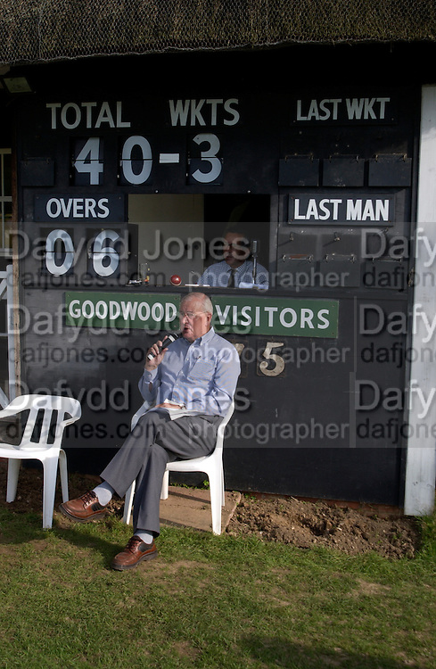 Nigel Draffan scoring and Allan Robinson commentating, The Duke of Richmond and Gordon's X1 V The Earl of March and Kinrara's X1. Cricket match before the Goodwood Revival meeting, 2 September 2004. SUPPLIED FOR ONE-TIME USE ONLY-DO NOT ARCHIVE. © Copyright Photograph by Dafydd Jones 66 Stockwell Park Rd. London SW9 0DA Tel 020 7733 0108 www.dafjones.com