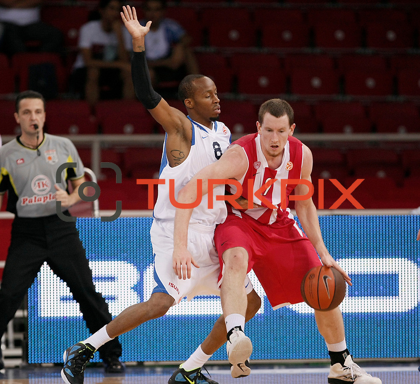Anadolu Efes's Terence KINSEY (L) and Olympiacos's Matthew HOWARD (R) during their Two Nations Cup basketball match Anadolu Efes between Olympiacos at Abdi Ipekci Arena in Istanbul Turkey on Sunday 02 October 2011. Photo by TURKPIX