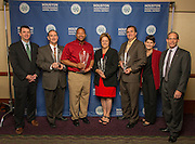 L-R: Houston ISD Chief School Support Officer Andrew Houlihan, IPAA President & CEO Barry Russell, Target Group Vice-President for South Texas Dell McKinney, Houston Astros Senior Vice President for Community Relations Meg Vaillancourt, Houston Food Bank President & CEO Brian Greene HISD Chief Business/Community Relations Officer Michele Pola and HISD Trustee Greg Meyers pose with a Hall of Fame trophy following the Houston ISD Partnership Appreciation breakfast at Kingdom Builders, October 25, 2013.