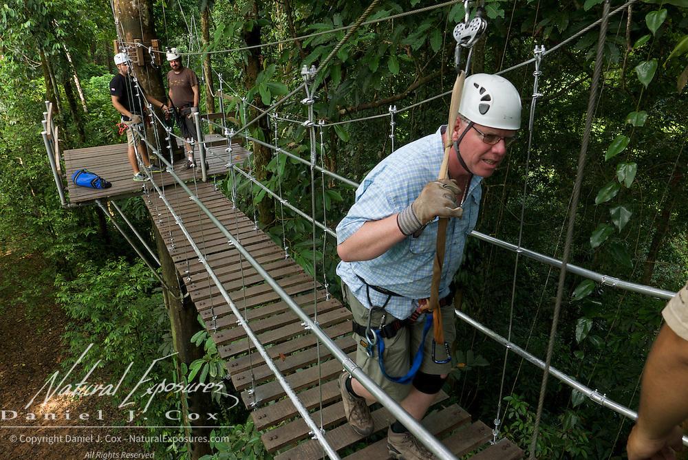 Paul on suspension bridge during zip line run. Costa Rica.
